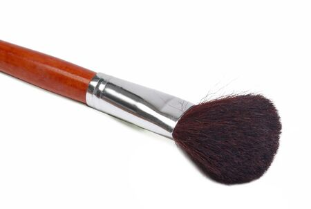 The cosmetic brush is isolated on a white background