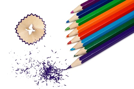 The grinded color pencils are isolated on a white background