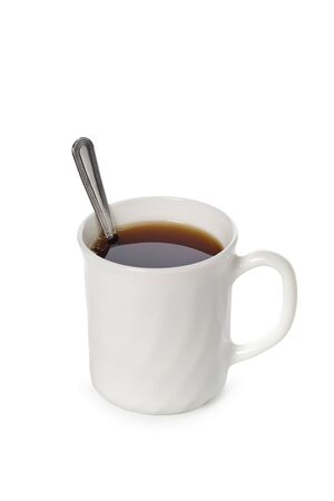 Mug with tea and a teaspoon are isolated on a white background