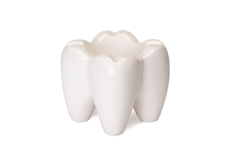 The ashtray in the form of a tooth is isolated on a white background Stock Photo