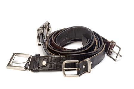 Old leather belts are isolated on a white background  Stock Photo