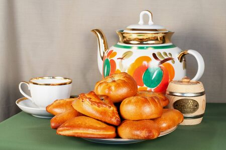 Still life with tea service and pastries  photo