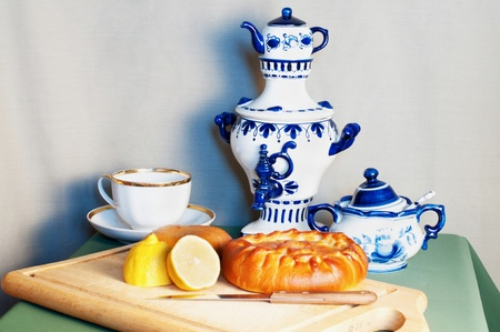 set, painted in the style of Gzhel, with pastries  photo