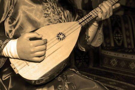 saz: playing Turkish saz  Stock Photo