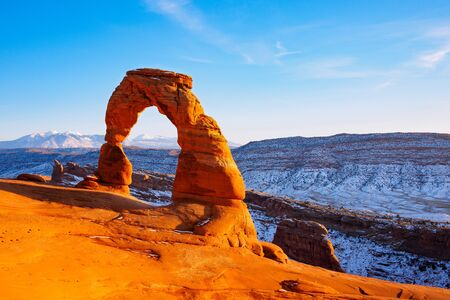 north window arch: Delicate Arch at sunset in snow season, Arches National Park, Utah