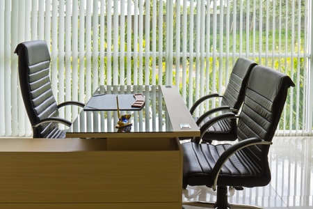 Chief executive or manager office with desk and armchairs