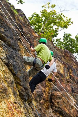 rappelling: Cliff abseilling recreation in Nakorn Nayok, Thailand