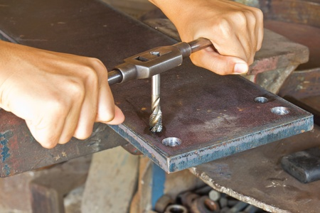 Manually making female thread with hand and die (tap) tool