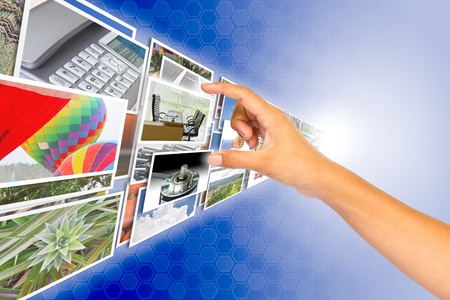 user friendly: Hand choosing an image from images stream, digital and network background, multimedia concept