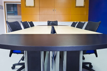 Meeting room with two tone table and armchair