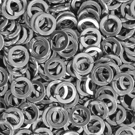 Pile of stainless steel spring washers, a shop floor item