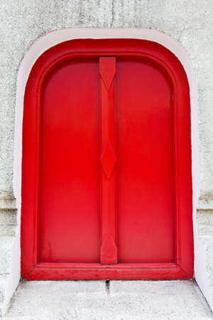 Red entrance on pebble grain concrete wall, permission concept Stock Photo - 12220730