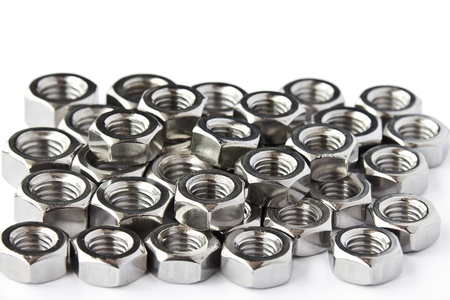 Pile of stainless steel nuts, a shop floor item, shallow DOF Stock Photo - 12963694