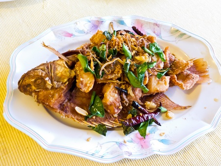 Fried mango fish  nilotica fish , topped with Thai herbs and nut Stock Photo - 13756516
