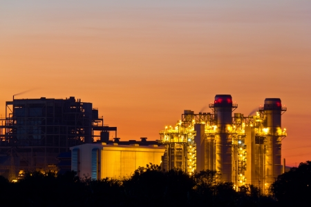 electric generating plant: Gas turbine electrical power plant at dusk with orange sky