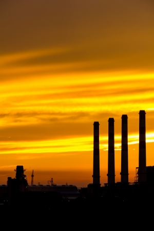 Silhouette of gas turbine electrical power plant at dusk Stock Photo