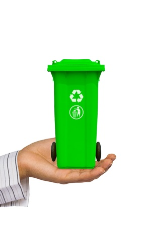 Hand offer green trash can  garbage bin  with recycle mark, isolated on white background