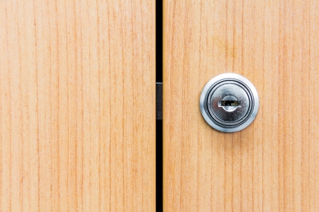 Close Up Of Locked Wooden Cabinet Door With Metallic Lock On Stock