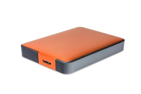 external hard disk drive: 2 5 inch  notebook size  external hard disk drive with usb 3 0 connector, orange color Stock Photo