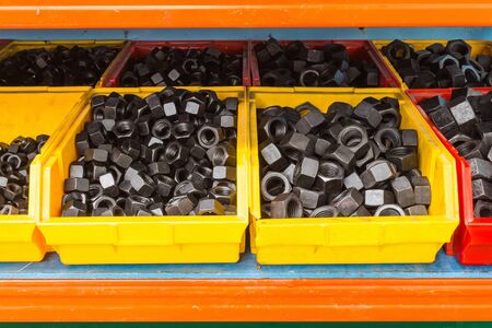 plating: Black oxide and oil plating nuts in plastic trays in the shop floor of factory