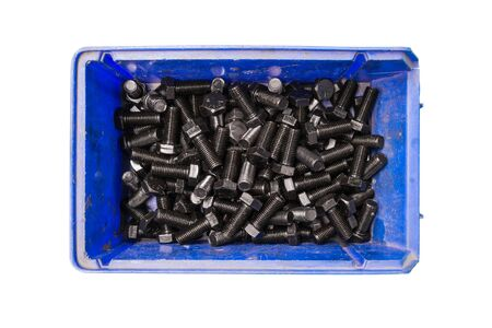 plating: Black oxide and oil plating bolts in plastic trays, isolated on white background