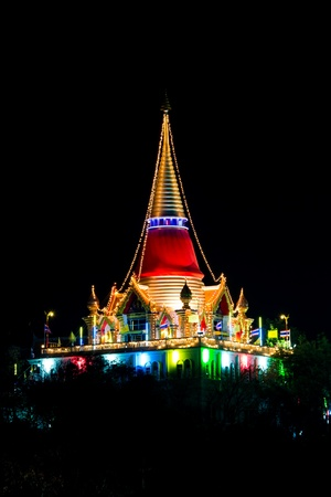 Annual lighting decoration on pagoda in night temple festival, Thailand photo