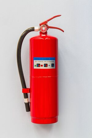 Dry chemical fire extinguisher on the factory wall Stock Photo - 18141011