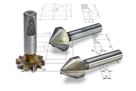Milling cutters, isolated on drawing background, with clipping path photo