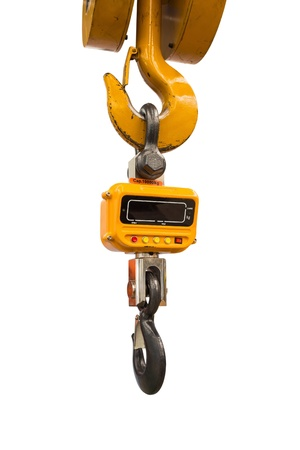 Industrial type digital weight scale hanging on hook of crane, isolated on white background