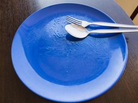 unwashed: Vuoto piatto non lavato dopo terminare il pasto