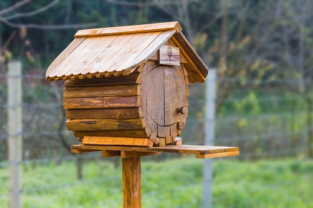 Birdhouse or homemade wooden mailbox with clipping path photo