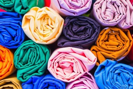 Close up of pile of colorful rolled t-shirt