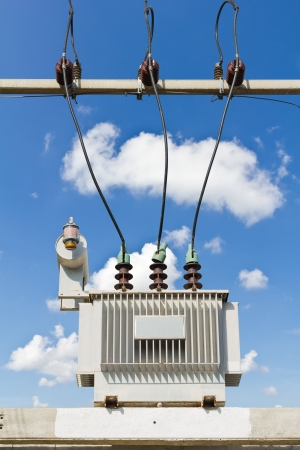 Three phase conservator type oil immersed transformer on concrete platform, isolated with clipping path photo