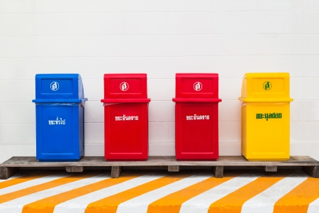 waste disposal: Four trash cans  Stock Photo