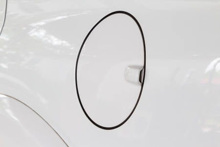 Close up of petrol cap cover on modern white car, a protection device of car photo