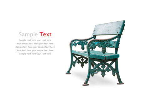 Old bench made of wood and metallic alloy frame, isolated on white background with clipping path photo