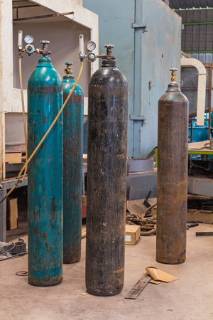 Compressed gas  argon or carbon dioxide or oxygen  steel cylinders for welding in metal workshop photo