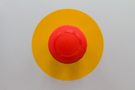 Close up of emergency stop button switch, an electrical device for safety photo