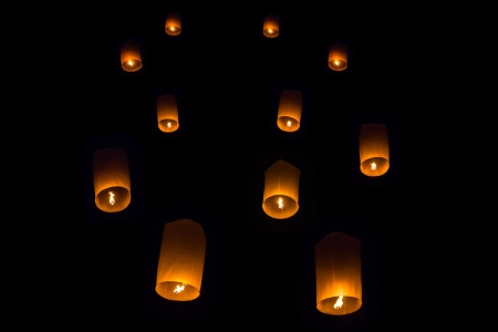 Yee peng floating lanterns in the dark sky, Thailand photo