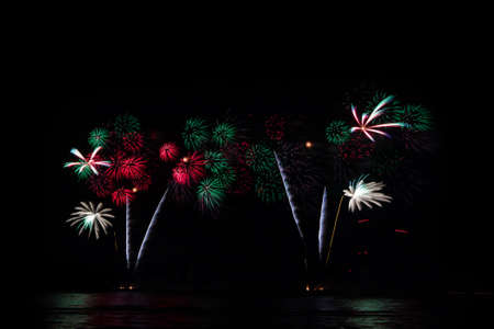 Fireworks in black sky, new year or independence day celebration photo