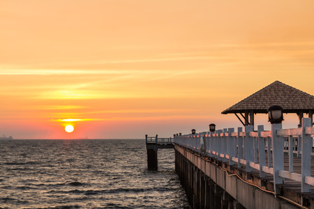 Beautiful sunset at wooden fishing pier photo