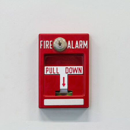Wall mounted fire alarm pull switch for activating fire fighting system