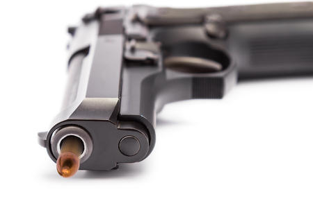 Close up of 9 mm  handgun focusing on the muzzle of gun with bullet head motion photo