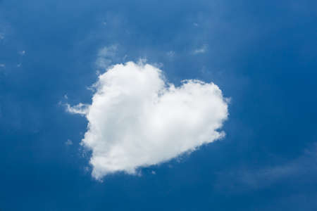 Heart shape white cloud in clear blue sky photo