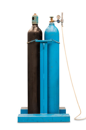 Compressed oxygen and compressed acetylene gas steel cylinders for welding, isolated on white background with clipping path 免版税图像