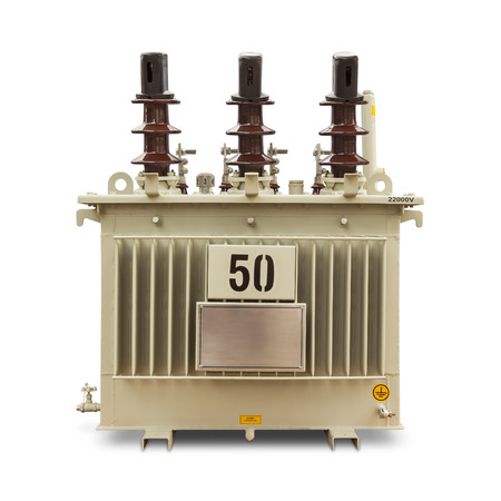 three phase: Three phase (50 kVA) corrugated fin hermetically sealed type oil immersed transformer, isolated on white background with clipping path Stock Photo