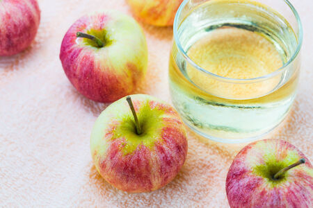 Close up of apples and a glass of apple juice photo