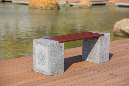 Garden bench beside the pond, the bench made of granite legs with Chinese style carving photo