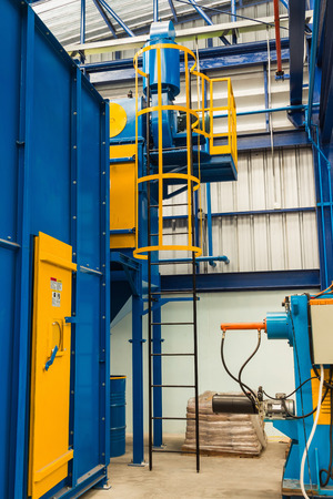 ladder safety: Fixed ladder with safety cages in the factory, mounted to the sandblasting machine