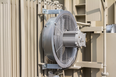 convection: Electrical cooling fan attached to the radiator fin of the transformer Stock Photo